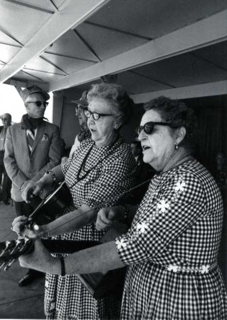 Effie Yates and Lillian Shaw, the Singing Grandmothers, along with Clyde Wolf and Richard Eliason.