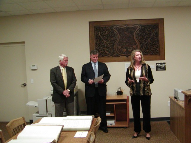 Official opening of the new Archives reading room. Left to right: Councilman Marvin Hendrickson, Mayor Peter Corroon, Administrative Services Director April Townsend.
